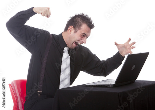 Frustrated businessman destroying his PC