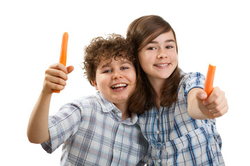Kids eating fresh carrots isolated on white background