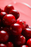 Cranberries in glass jug (detail)