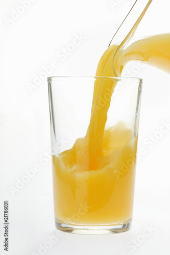 Pouring orange juice into juice glass
