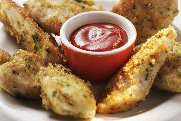 Chicken nuggets in herb panade with ketchup