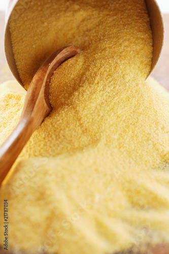 Polenta with wooden spoon and bowl