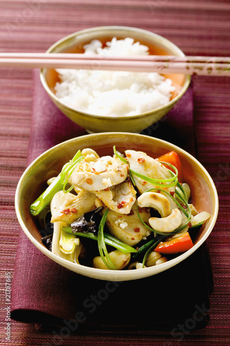 Swordfish with cashew kernels and vegetables, rice (Asia)