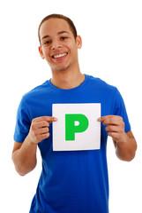 Teenage boy holding P plate