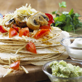 Fajitas with tomatoes, Portobello mushrooms & grated cheese