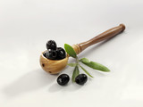 Black olives in a wooden spoon