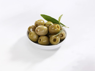 Green olives in a small bowl
