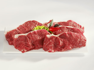 Five raw sirloin steaks