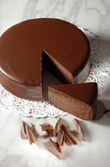 Sachertorte (Austrian chocolate cake) with a piece cut