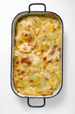 Potato gratin in roasting tin