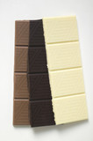 Pieces of three different chocolate bars