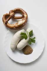 Weisswurst (white sausages) with mustard and pretzel