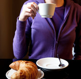 """woman drinking cappuccino at breakfast"