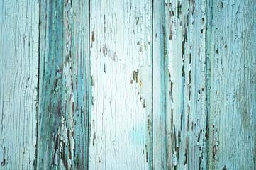 Light blue painted threadbare wooden plank
