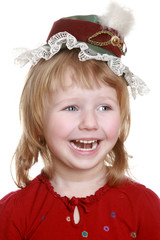 Happy little girl in red cap