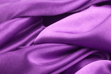 Purple textile texture with dark creases and selective focus poster