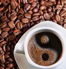 Foam in a cup of coffee as a symbol of yin yang