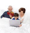 grandparents grandchild bed laptop
