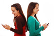 Girls laughing using phones