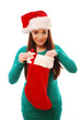 Girl getting gift out of Christmas stocking