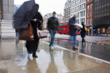 Busy london commuters in the pouring rain poster