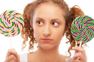 Beautiful girl chooses from two sugar candies
