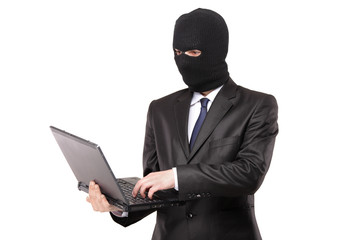 A hacker working on a laptop isolated on white background