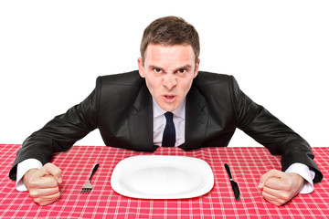 An angry man waiting his food in a restaurant