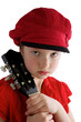Little girl with red hat and guitar