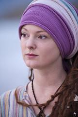 Beautiful young woman wearing purple headgear