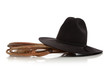 Black cowboy hat with lasso/lariat on white