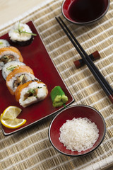 A complete sushi meal with chopsticks on tatami mat