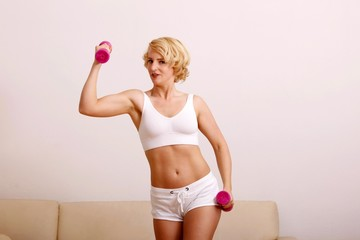 blond woman with dumbbell