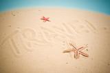 Travel handwritten in sand poster