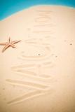 Vacation handwritten in sand poster