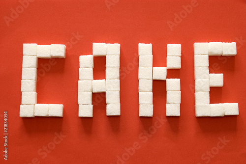 "Word ""cake"" from sugar slices"