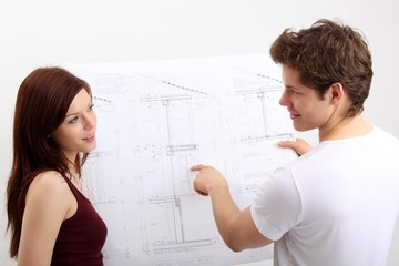 young couple with construction plan