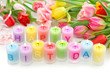 Birthday candles and tulips isolated on white background
