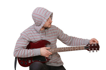 Young Man Tuning electric guitar