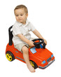 Happy child baby boy 1 year old drive red car