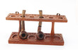 Old carved wooden pipe stand with pipes
