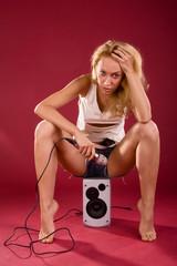 Girl on the sound speaker