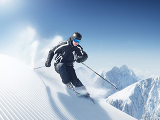 Skier in high mountains - alpen