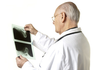 Senior doctor looking at X-ray