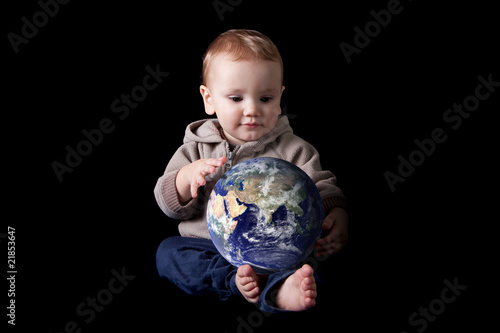 Boy holding world