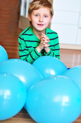 boy with blue balloons