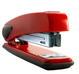 Red stapler on a white background