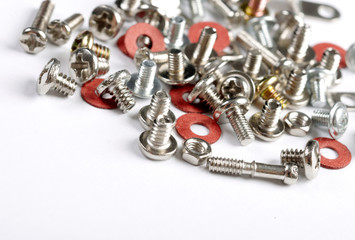 Screws, bolts and nuts on a white background.