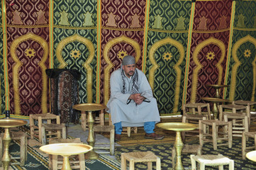 Man Sitting in an Arabian Tent
