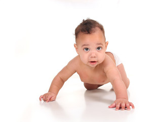 Infant Baby Boy Learning to Crawl on White